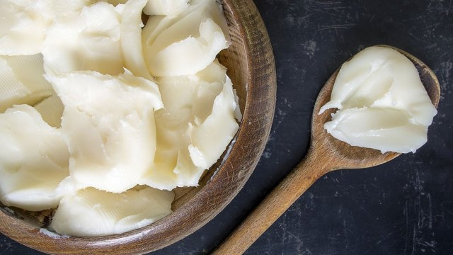 lard on a wooden spoon and bowl