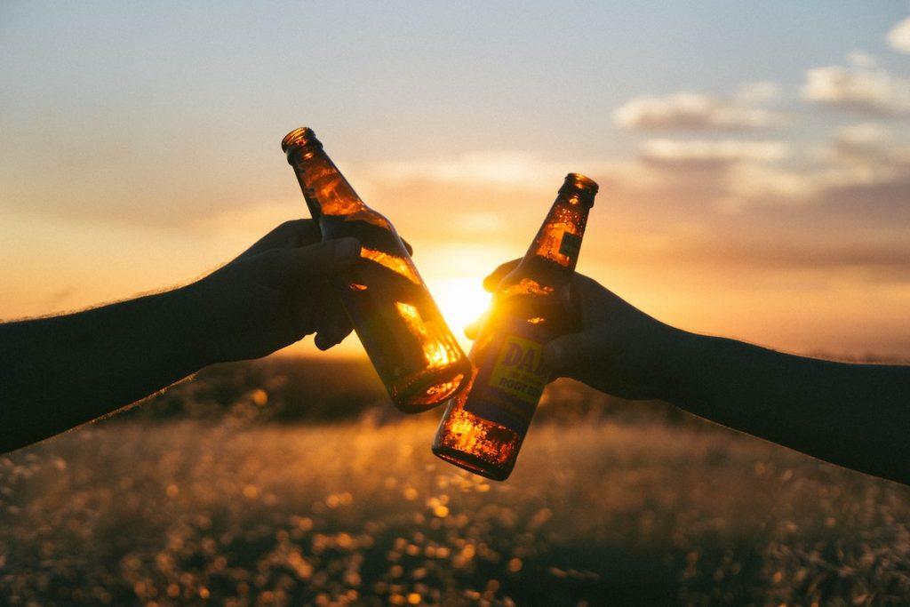 clinking beer bottles